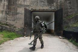 .North Korean soldier walks into South Korea across land border.