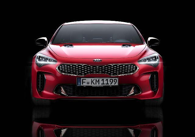 Kia unveils premium performance sedan Stinger at Detroit Auto Show