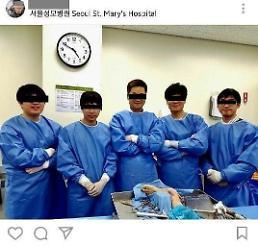 .Doctors punished for posting certification picture on cadaver.