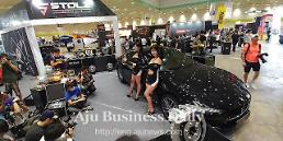.Car tuning and aftermarket exhibition attracts enthusiastic fans .