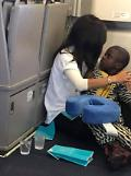 .Passenger steps in to comfort screaming Autistic boy on flight .