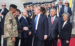 Moon departs from precedent to welcome Trump at U.S base