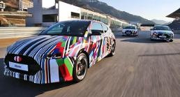 Hyundai unveils sneak peek at new hot hatchback Veloster