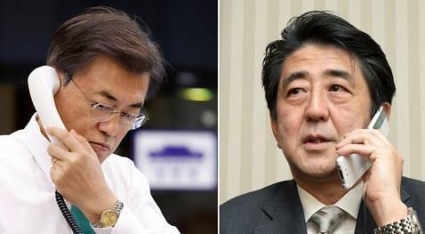 韩日首脑通电话称不容朝鲜威胁安全