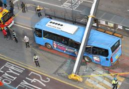 .Tower crane collapses onto bus, kills 1, injures 15 passengers.