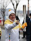 [OLY] IOC head carries Olympic torch on opening day: Yonhap