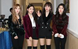 .N. Koreas Kim voices excitement at concert by Red Velvet and other artists.