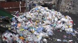 .韩政府与垃圾回收企业意见差难缩小 长期垃圾成山引担忧.