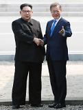 .[SUMMIT] Leaders of two Koreas shake hands across borderline in truce village .
