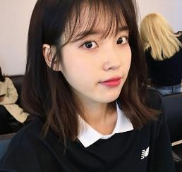 .Singer IU makes cash donation to help children in need.
