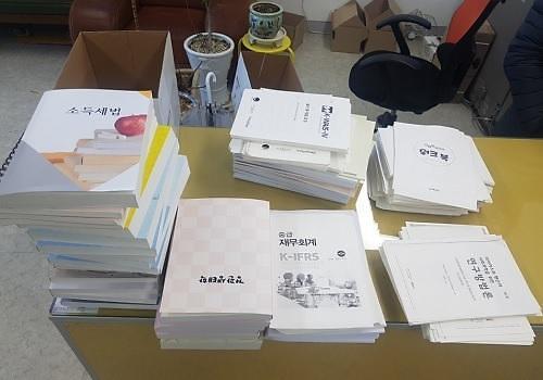 开学在即 韩政府将严打非法复印教材乱象