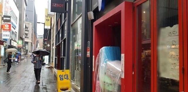 韩国明洞购物天堂地位下降 国际知名品牌接连撤出