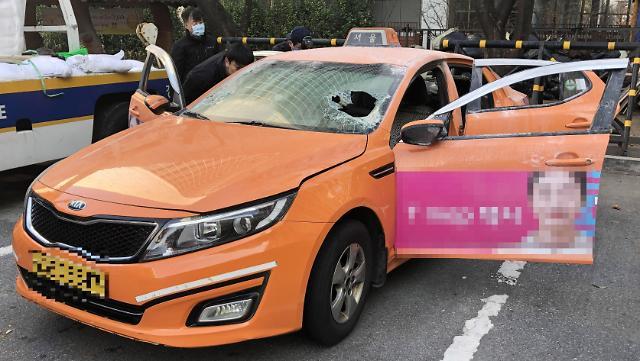 反对拼车软件服务 韩一出租司机在国会前自焚身亡