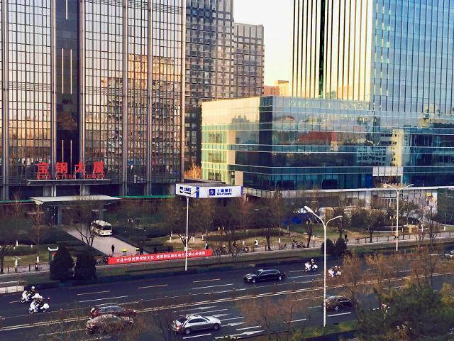 金正恩在京参观同仁堂工厂