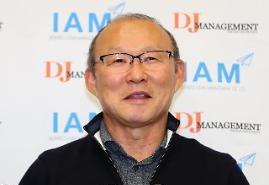 Huấn luyện viên Park Hang - seo rạng rỡ về quê hương đón tết