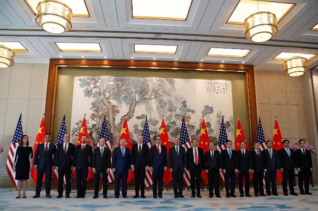 """SCMP """"미·중 협상단 이르면 25일 회담"""""""