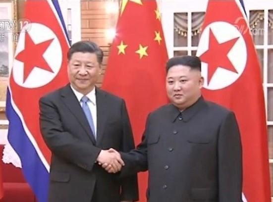 习近平:将帮助朝鲜解决半岛问题 与朝鲜合力推进无核化谈判