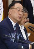 .Top economic official urges dialogue with Japan to solve disputes .