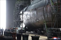 .N. Korean leader inspects newly built submarine for deployment off east coast: state media.