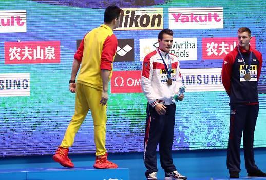 国际泳联对孙杨和斯科特发出警告