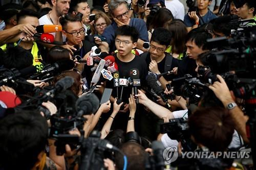 우산혁명 주역 체포 논란... 홍콩 시위 격화 우려