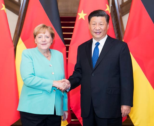 中 방문 메르켈에 심기 불편한 중국 언론