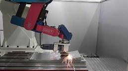 ​Researchers develop robotic arm capable of processing cars surface in production
