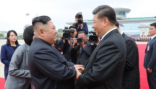 金正恩回电习近平巩固发展朝中友谊