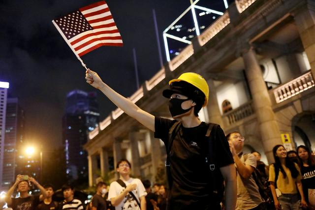 [NNA] 홍콩 정부에 복면금지법 조기 입법화 촉구... 中 인민일보