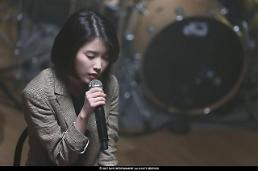 .Singer-actress IU postpones release of new album to express condolence on Sullis death.