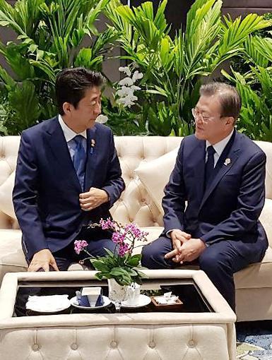 韩日领导人一致认为需以对话解决问题