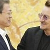 .​[PHOTO] President Moon meets rock band U2s Bono.