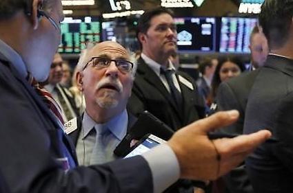 [纽约股市收盘]明年利率冻结信号3天后反弹