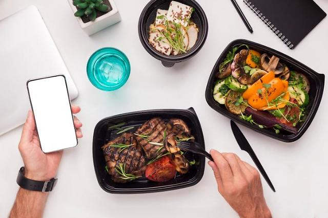 Merger of food delivery service apps face objection by franchise shop owners