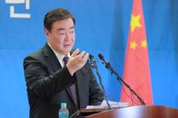 .Chinese envoy expresses guarded displeasure at strict travel ban.