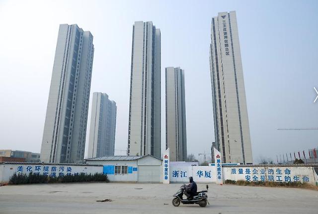 코로나19 쇼크에…중국 부동산 주식, 채권 일제히 폭락