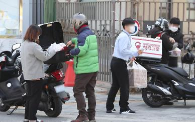 .Small business owners criticize food delivery service Baedal Minjok for raising commission.