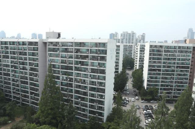 在首尔拿最低工资 多少年购买一套房?