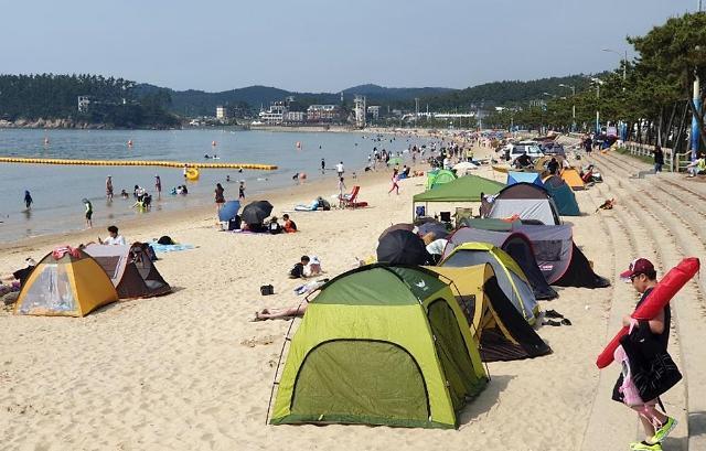 露营成疫情下韩民众出游首选 帐篷销量大增不文明行为频现