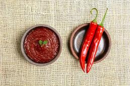 .K-dramas boost popularity and exports of Korean chili pepper paste Gochujang .