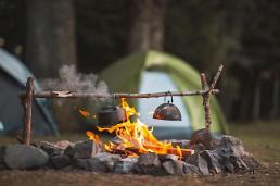 .COVID-19 blue keeps camping season going on despite autumn chill in S. Korea.