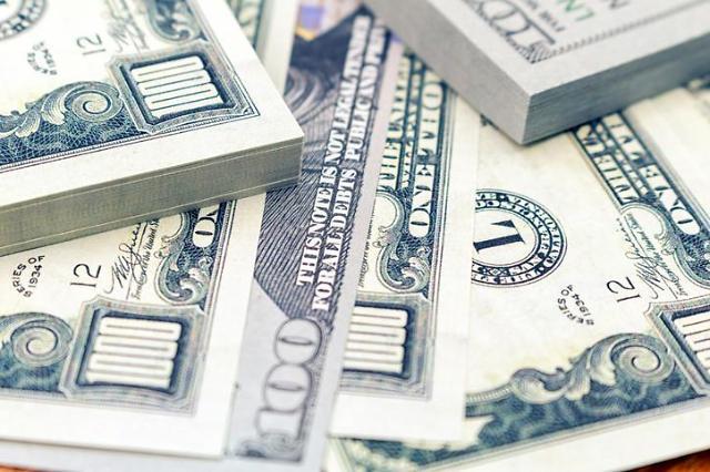 바이든 시대 개막에 원·달러 환율 보합권…1099.0원 출발