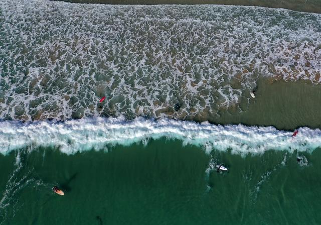 Daredevil surfers to be fined for ignoring storm warning