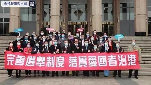 完善香港特区选举制度是民心所向