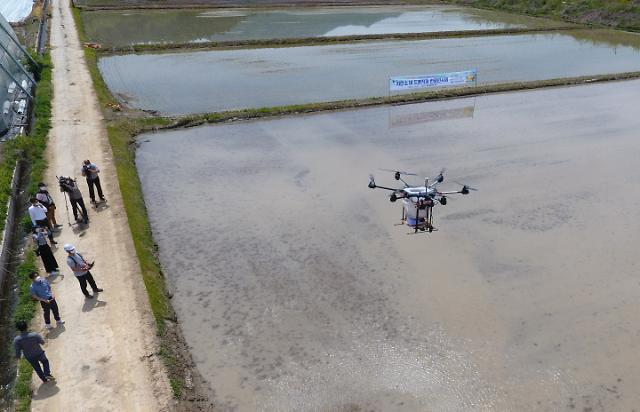 Agricultural research institute demonstrates rice seed-sowing drone