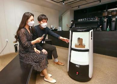 Woowas intelligent delivery robot awaits crucial test operation at modern building in central Seoul