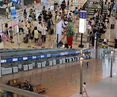 텅 빈 인천공항 VS 꽉 찬 김포공항…코로나19 여파에 공항 풍경도 극과 극