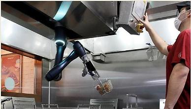 S. Koreas fried chicken franchise Kyochon opens first store with cooking robot