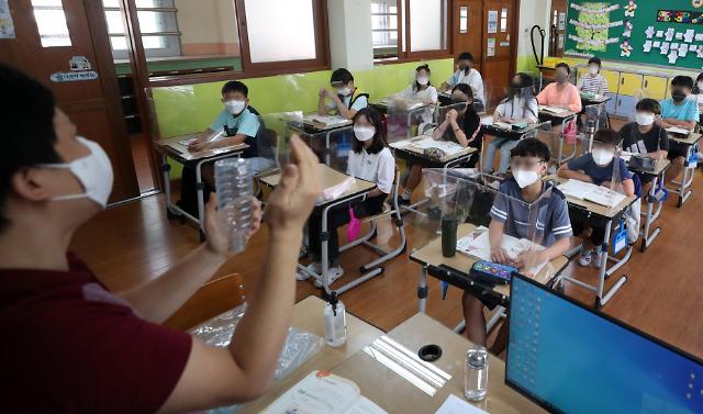 """韩青瓦台:""""与疫共存""""不代表能摘口罩"""