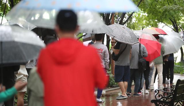 韩国新增1347例新冠确诊病例 累计334163例